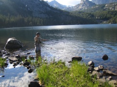 Fly fishing for golden trout in an alpine lake.